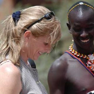 Martha Fischer and a scout in Kenya